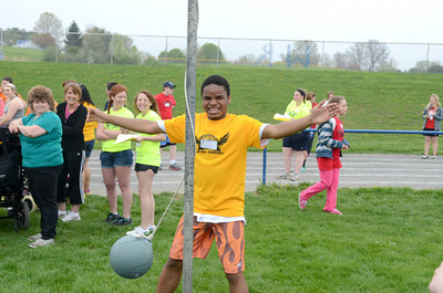 Selinsgrove special education student Isaih Burtton smiles while playing tether ball on Friday during a special education field day at the Warrior Run High School football field.