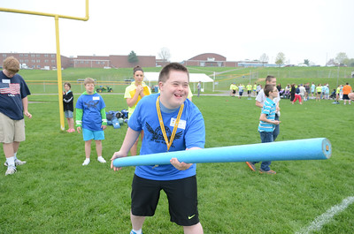Warrior Run special education student Adam Strouse enjoys throwing a homemade javelin during a field day for special education students at the Warrior Run High School football field on Friday.