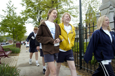 St. Monica students Sabrina Sinsel, 13, left, and Zoe Green, 13, walk around Cameron Park on Friday morning.