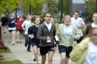 St. Monica students walk and run around Cameron Park in Sunbury on Friday.