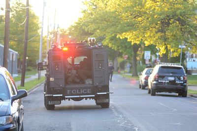 An armored vehicle makes its way down Orange Street in Northumberland on Monday evening during a standoff.