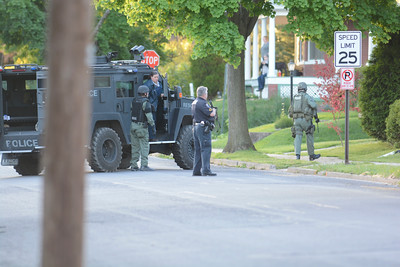 Police stand near an armored vehicle on Orange Street in Northumberland during a standoff on Monday evening.