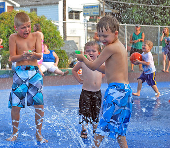 "Amanda August/For The Daily Item Two boys have a water gun battle at the Oppenheimer Pleasure Grounds on Thursday night during ""Family Fun Night"" part of the Sunbury Celebration."
