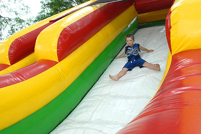 Derek Kalcich, 4, of Sunbury sails down the blow up slide at the annual Sunbury Fireman's Festival Saturday June 9, 2012.