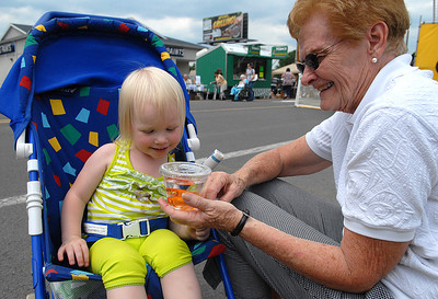 Ryleigh Rider, 2, of Sunbury take a moment to get to know her new fish with her grandmother, Marjorie Harris, during the Sunbury Fireman's Festival Saturday June 9, 2012.