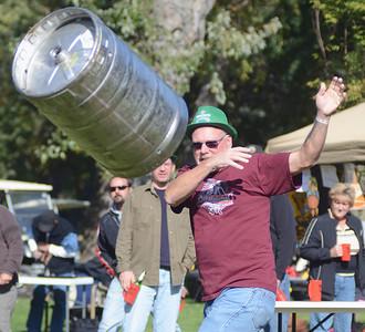 Doug Beaver, of Sunbury, throws a keg during the Sunbury Social Club's Oktoberfest keg toss competition on Saturday afternoon on Packer Island.