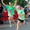 Molly Shoup, 16 of Elysburg, and Hannah Sage, 15 of Catawissa, run across the finish line of the TaTa Trot on Saturday morning in Sunbury.