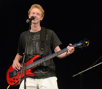 Jacob Roman, lead singer and bassist for Covert Expression out of Lewisburg, performs with his bandmates, Jacob Logan, Ian Seasholtz and Ryan Winas, during the annual The Valley's Got Talent contest Thursday night Aug. 16, 2012 at Shikellamy High School.