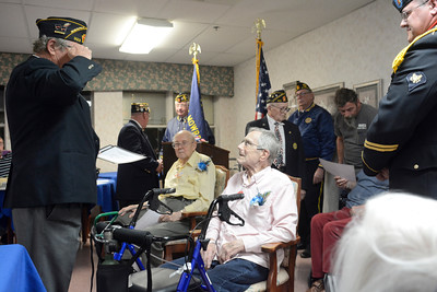 Barry Buck, Watsontown American Legion Post 323 adjutant, left, salutes US Navy veteran John Artz on Tuesday evening during a Veteran's Day ceremony at the Watsontown Nursing and Rehabilitation Center.