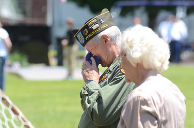 Vietnam veteran Kenny Feese, Coal Township, is comforted by Loretta Poliniak, Coal Township, during a ceremony on Saturday in Union Town, with the traveling Vietnam Memorial wall.
