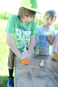 James Brantingham, left, and Brendan Geiger, squeeze the juice out of a lemon as they and fellow Warrior Run fifth grade students had their On Site Day at the Hower-Slote House.