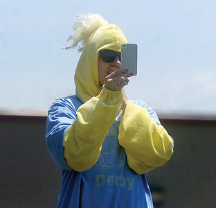Mindy Dull, of DJD Fight On Foundation, takes pictures during the Duck Derby in Watson on Sunday.  Proceeds from the Duck Derby went to the foundation.