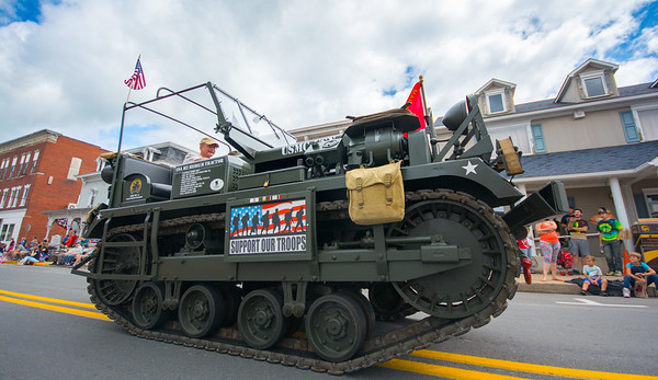 A military tractor goes down Main Street in Watsontown as part of the Gigantic Sesquicentennial Parade on Saturday morning.