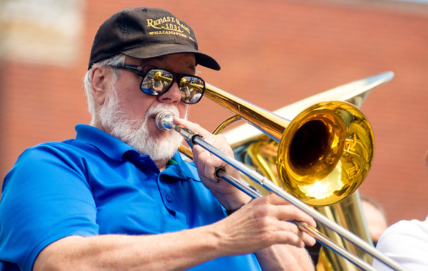 A member of the Repasz Band of Williamsport, plays a trombone during the  Gigantic Sesquicentennial Parade in Watsontown on Saturday.
