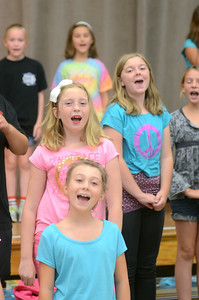 Milton Elementary school students from bottom, Leslie Krebs, 10, Mya Cromwell, 10, and Zoe Paul, 11, sing during Tuesday's rehearsal for their production of What's Shakin', Shakespeare? at the James F. Baugher Elementary School.