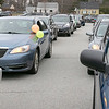 Teachers and staff from the Northwest Elementary School in Leominster had a car parade throughout some of the city. Cars are lined up waiting for the parade to start. SENTINEL & ENTERPRISE/JOHN LOVE