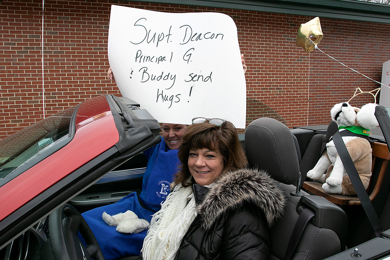 Teachers and staff from the Northwest Elementary School in Leominster had a car parade throughout some of the city. Principal Colleen Gihooly and Superintendent Paula Deacon, holding sign, wait for the parade to start in the parking lot of Northwest. SENTINEL & ENTERPRISE/JOHN LOVE