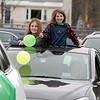 Teachers and staff from the Northwest Elementary School in Leominster had a car parade throughout some of the city. Waiting for the parade to start is Addison and Emily Mistler with their mom Sarah Mistler a second grade teacher at Northwest. SENTINEL & ENTERPRISE/JOHN LOVE