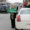 Teachers and staff from the Northwest Elementary School in Leominster had a car parade throughout some of the city. Watching the parade from West street at Monument Square is Beth Whigham with her son Northwest first grader Benjamin Johnson, 7. SENTINEL & ENTERPRISE/JOHN LOVE
