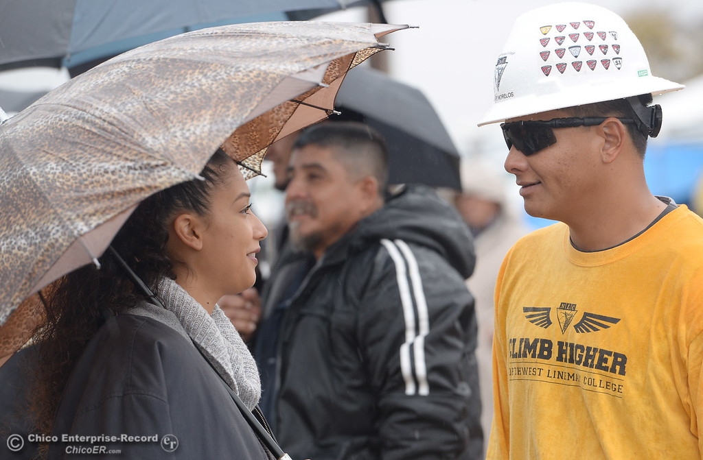 . Esmerelda Beltran left, smiles at her boyfriend Javier Moelos during the Northwest Lineman College Rodeo in Oroville, Calif. Fri. Nov. 10, 2017.  (Bill Husa -- Enterprise-Record)