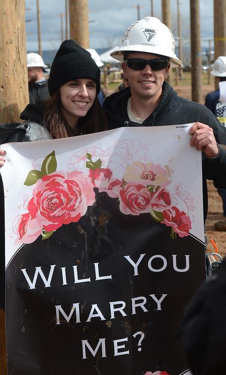 . AJ Bondietti proposes to his girlfriend, Natalie Blacker, during Northwest Lineman College\'s graduation rodeo, March 15, 2018, in Chico, California. (Carin Dorghalli -- Enterprise-Record)