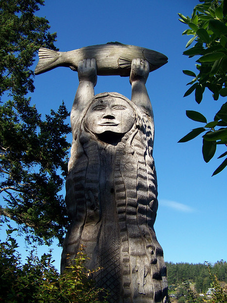 On the other side of the statue, the maiden is depicted as a water creature with seaweed hair.<br /> [Deception Pass State Park]
