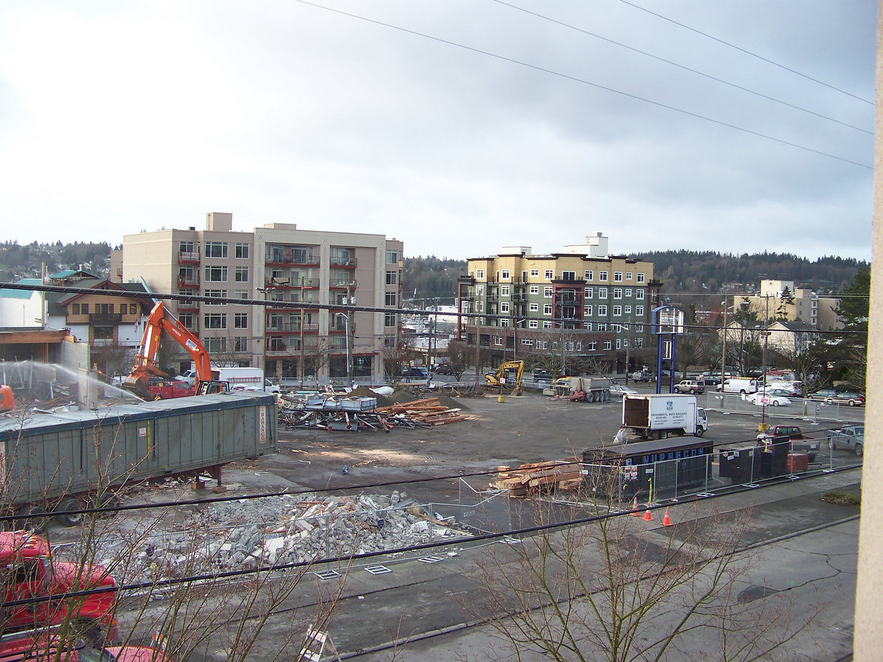 January 9, 2008.  The old Ballard QFC.  The parking lot was stil intact to the west of the demolished store.  On the edge of the parking lot near 24th Ave NW, the blue structure that held the store's sign is still standing.
