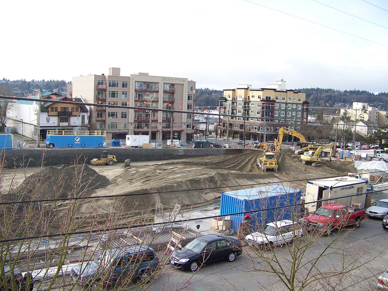 "February 20, 2008.  The old Ballard QFC's parking lot is now gone, and excavation for the new building's foundation is underway.  The new building will be called ""On the Park."""