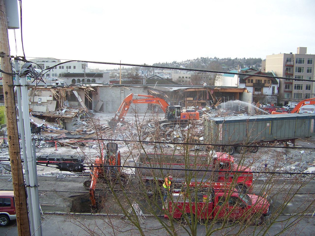 The old Ballard QFC grocery store next to the park (and directly across from my building) shut down during the first week of December 2007.  Demolition began in early January 2008.