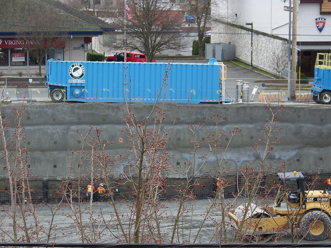 "March 4, 2008.  The pit for Ballard's ""On the Park"" apartment building is now about as deep as it's going to get.  For scale, note the guys at the base of the wall."