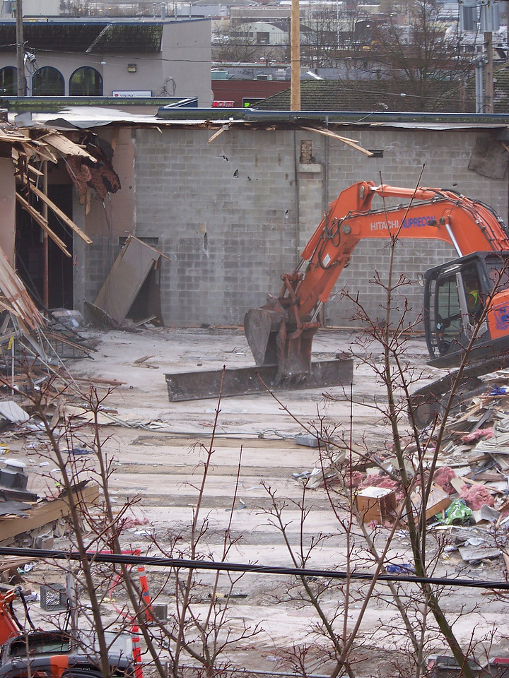 January 9, 2008.  The old Ballard QFC.  As the demolition debris is cleared away, you can see where the store's shelving once stood on the concrete foundation.