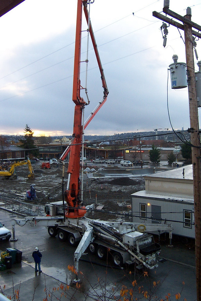 In October 2005, this large piece of equipment was brought in to pour the concrete for the skate bowl and walkways in Ballard Commons Park.  The street was blocked for several days while this work went on.