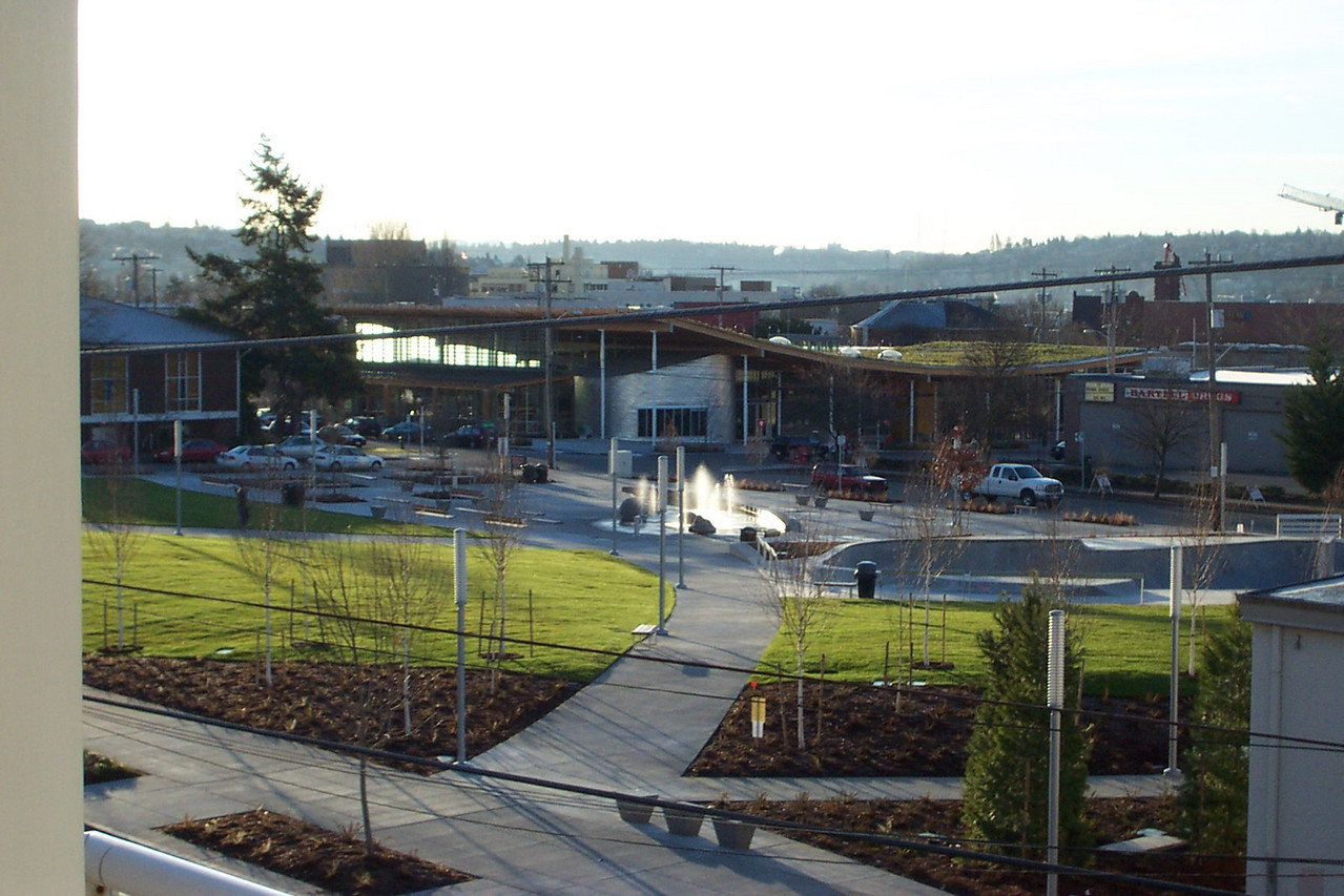 In February 2006, the fences around the lawn are gone, and the water feature (children's play area) is first turned on at Ballard Commons Park.
