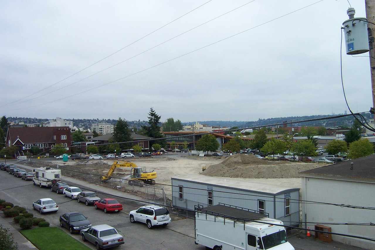 In August 2005, construction of Ballard Commons Park begins with removal of all the remaining concrete and asphalt from the old Safeway store and parking lot.