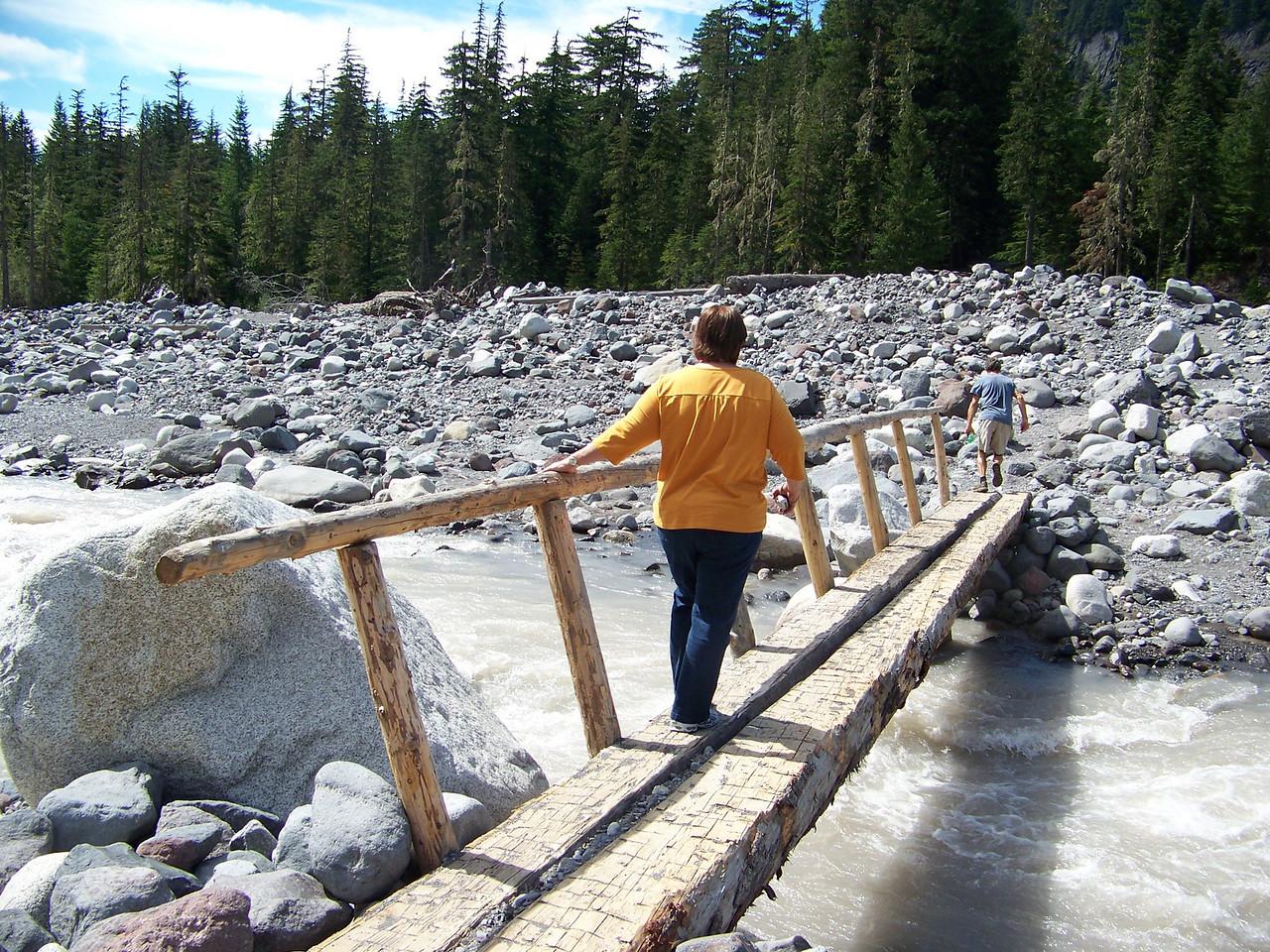 Wendy crosses the bridge over the Nisqually River.<br /> [Mount Rainier]