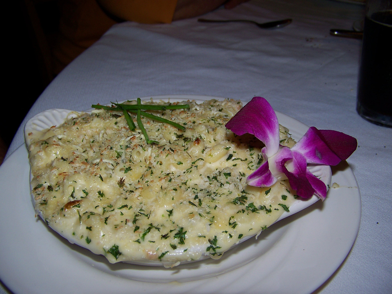 Mark decided on the crab macaroni and cheese for dinner, which came garnished with an orchid.  He let me sample it, and boy, was it good!<br /> [Mount Rainier - Paradise Inn]