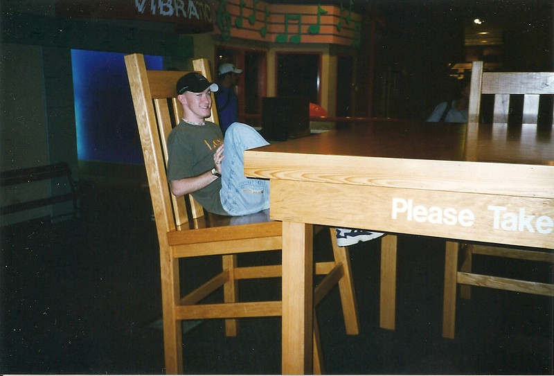 Josh sitting at a gigantic table.  Or is that a tiny version of Josh at a normal-sized table?  Hmmm.  I can't quite remember where this was.  Probably the Pacific Science Center, which is close to the Space Needle.