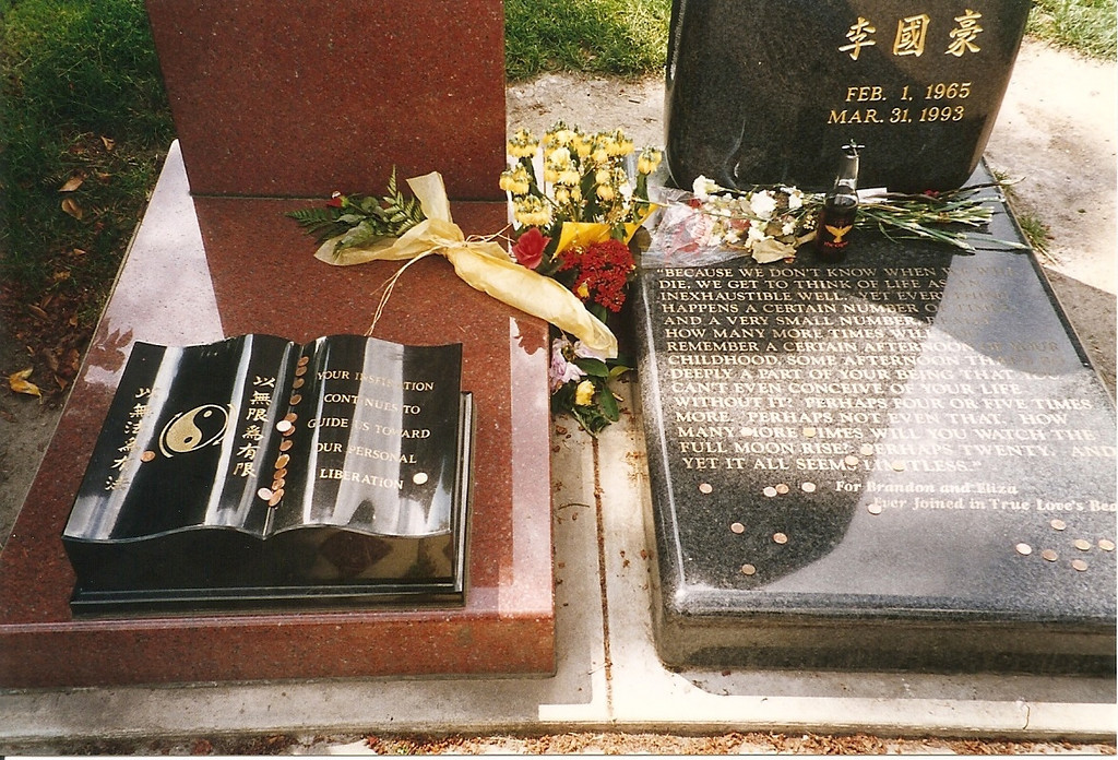 Close-up of the detail on Bruce & Brandon Lee's headstones, and the many rememberances people have left behind.  Leaving coins on a grave is an Asian custom.