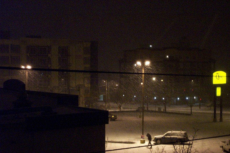 The following day, November 29, 2006, some more snow fell in the evening.  Look carefully under the lights, and you can see it falling.
