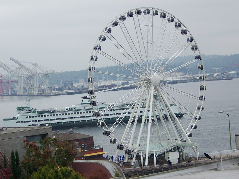 Our next stop was the Waterfront's newest attraction, the Seattle Great Wheel (seen here in front of a departing ferry).  This Ferris wheel had just opened about four months earlier.  I hadn't had a chance to ride it yet, so I dragged the reluctant Wendy with me.