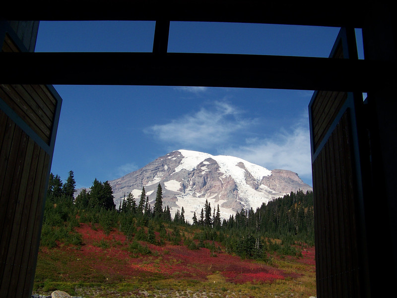 Mount Rainier framed by the doorway of the Paradise visitor center.