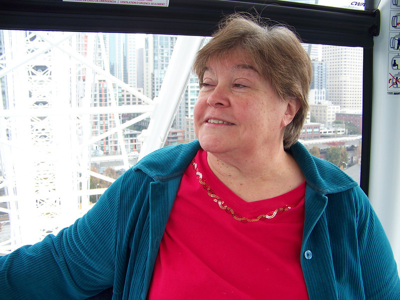 """Wendy puts a brave face on her fear of heights while riding the Seattle Great Wheel.  Thanks for being a good sport!  The height bothered me a little, but I was more freaked out by how """"delicate"""" the structure seemed.  It felt like it was swaying slightly, but maybe that was just my imagination...."""