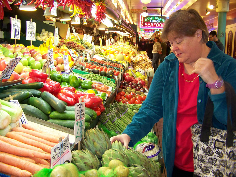 Wendy checks out the produce at the Pike Place Market.