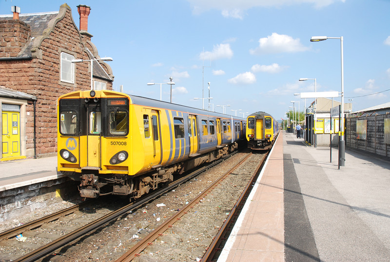 507 008 / 156 441 <br /> <br /> Location Ellesmere Port <br /> <br /> Date 30th June 2011 <br /> <br /> Looking towards Stanlow the 507 is on the frequent Merseyrail service to Liverpool