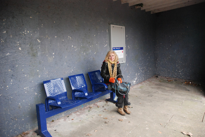 Liz in the what passes for a waiting room at Ince and Elton Ellesmere <br /> <br /> Port bound platform one thing of intrest here was that since my last <br /> <br /> visit here all the poster cases are now empty except for the one <br /> <br /> behind Liz that had the mega Timetable in it