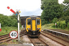 156 428 runs out of Helsby station and heads for the Shunt signal just <br /> <br /> other side of the Bridge