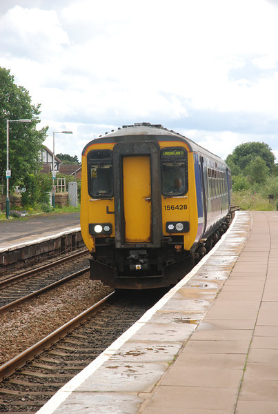 Date 30th June 2012<br /> <br /> 156 428 <br /> <br /> Location: Helsby <br /> <br /> Working: 5F14 14.58 Chester - Helsby ECS to form the 15.17 Helsby - <br /> <br /> Ellesmere Port Parly move