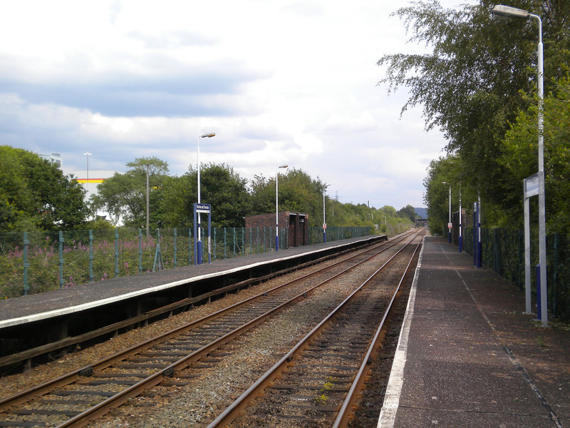 Shot taken from the Ellesmere Port bound platform looking towards <br /> <br /> Ince & Elton the platforms here are very long the unit when it arrives <br /> <br /> is dwarfed by the size of the platforms