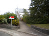 The entrance to Stanlow & Thornton is just off the main road<br /> <br />  that runs through the Oil refinery the above shows the remarkably <br /> <br /> well kept entrance to Stanlow & Thornton