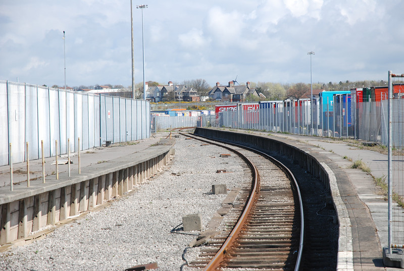 Shot of the Platform looking towards Morecambe as can be seen <br /> <br /> from this picture the platforms where very long at one time no doubt <br /> <br /> to accomadte 12 coach boat trains i assume. <br /> <br /> On the left can be seen the remains of the old platform now <br /> <br /> abandonded also of note was that behind that very high security <br /> <br /> fencing that was on both sides are secure lorry parking <br /> <br /> compounds!!!
